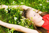 Young woman resting in grass — Stock Photo