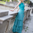 Young slim woman in dress - Stock fotografie