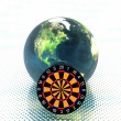 3D earth with darts - Stock Photo