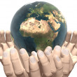 Stock Photo: Earth in hands isolated on white