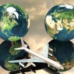 Постер, плакат: Airliner with a globe