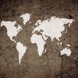 Stock Photo: Old world map on retro paper