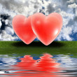 Red hearts on the grass — Stock Photo