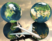Airliner with a globe — Stock Photo