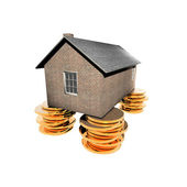 House on the golden coins — Stock Photo