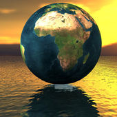 Globe on the water — Stock Photo