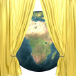 Earth with golden drapery on a white — Stock Photo