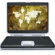 Stock Photo: Retro model of geographical world map on laptop screen