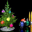 Christmas tree ornaments balls and candles — Stock Photo
