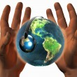 Stock Photo: 3D earth on 3D hands