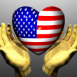 Heart with us flag texture in golden hands — Stock Photo