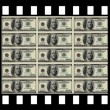 Film with 100 us dollar notes — Stock Photo #1883862