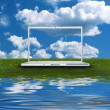 Blank laptop computer on the green grass — Stock Photo