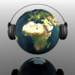 Music earth globe with headphones — Stock Photo