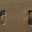 Footprints on the Sea beach sand — Stock Photo
