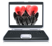 Valentine red heart on laptop screen — Stock Photo