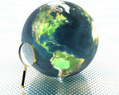 3D earth with magnifier — Stock Photo