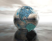 3D globe on water in silver — Stock Photo