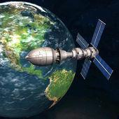 Satelite sputnik orbiting earth in space — Stock Photo