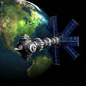 Satelite sputnik orbiting earth — Stock Photo