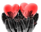 Bright red glass hearts in hands — Stock Photo