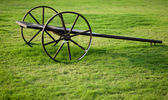 Old empty cart on green grass — Stock Photo