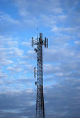 Communications tower with antennas — Stock Photo