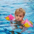 Little girl in swimming pool — Stock Photo #1237608