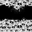 Vector background filled with skulls — Imagens vectoriais em stock