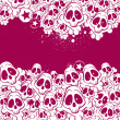 Vector background filled with skulls — Stock Vector