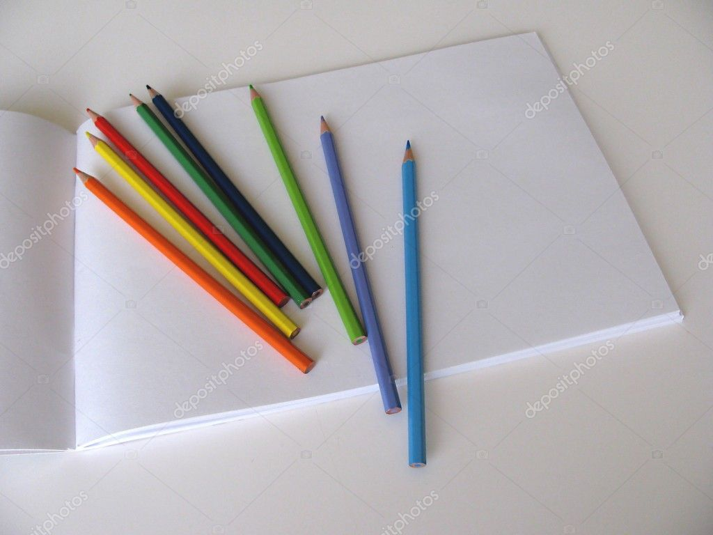 Album and color pencils on white background — Stock Photo #1244638