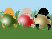 Multiracial babies with easter eggs — Stock Photo