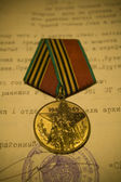 "Medal ""Forty years of the Victory"" photographed against the archival document — Stock Photo"