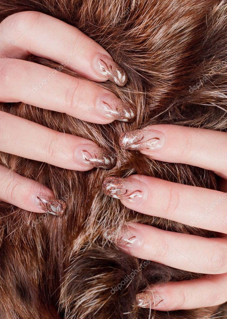 Fingers with a manicure in the fur — Stock Photo #1425595