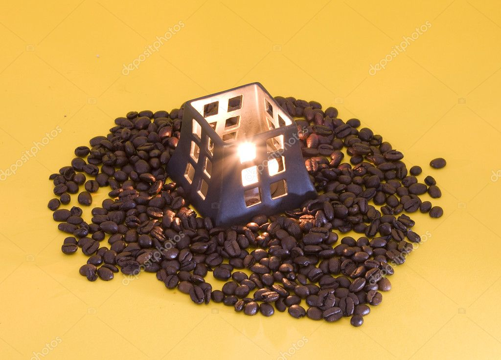 Light candle's flame and coffee beans  Stock Photo #1133762