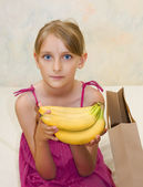 Young beautiful girl with banana — Stock Photo
