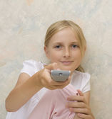 Teenager girl with remote control — Stock Photo