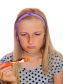 Teenager girl cleaning tooth — Stock Photo
