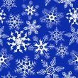 Blue background with snowflakes - Stok Vektör