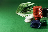Dibs and money on the casino table — Stock Photo