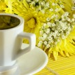 Morning cup of coffee with flowers — Stock Photo