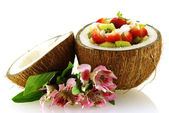 Fresh fruit salad served in half coconut — Stock Photo