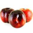Three fresh ripe sweet plums — Stock Photo