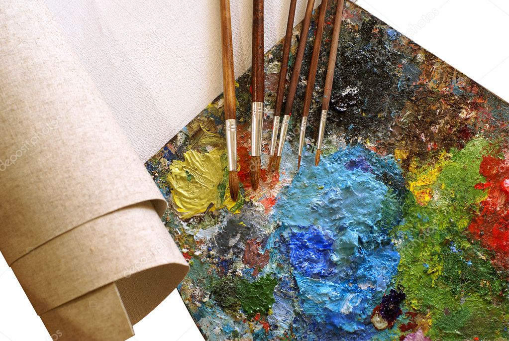 Set for painting - canvas, palette, paintbrushes over white background  Stock Photo #1157681