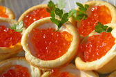 Canapes with red caviar — Stock Photo