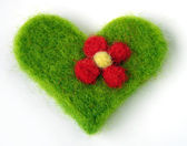 Green felt handmade heart — Stock Photo