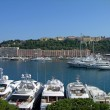 Luxury yachts in Monaco harbor - Stock Photo