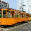 Old orange trams in Milan - Stock Photo
