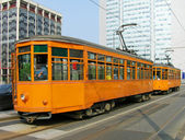 Old orange trams in Milan — Stock Photo
