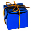 Small dark blue gift with a golden ribbo — Stock Photo #1138320